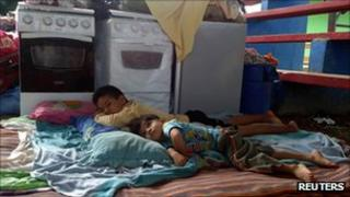 Children rest in a flood evacuation centre in Cobija, northern Bolivia