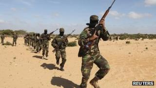 Members of Somalia's al-Shabab militant group parade during a demonstration to announce their integration with al-Qaeda south of the capital, Mogadishu, on 13 February 2012