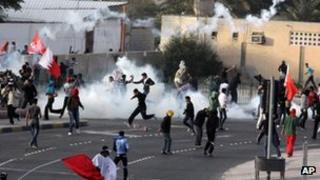 Police use tear gas to disburse protesters outside the capital Manama