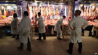 Butchers in the Omonia market district, Athens