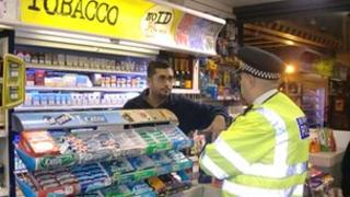 Officer speaking to shopkeepers