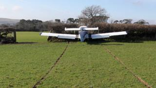 The aircraft ended up in a hedge