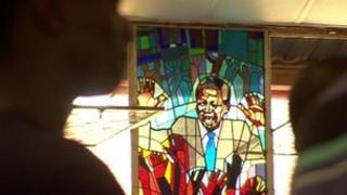 A Nelson Mandela stained glass window at Soweto's Regina Mundi church