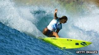 Surfer using a Billabong board