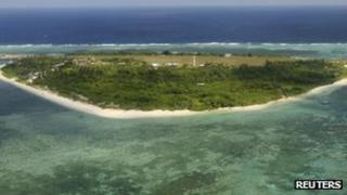An aerial view shows the Philippines-controlled Thitu Island - part of the disputed Spratly Islands - in South China Sea, 20 July 2011