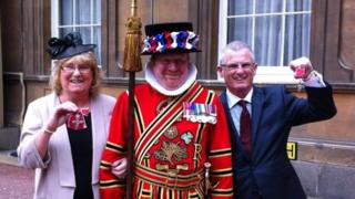 Patricia and John Bonthron with their MBEs at Buckingham Palace