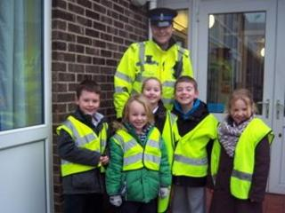 PCSO Mark Taylor with some of the children