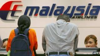 Customers at a Malaysia Airlines counter