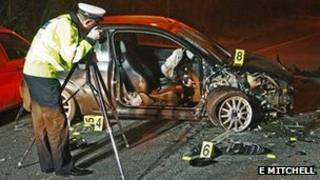 Police officer photographing scene of accident