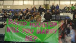 Lisa Britton with her banner