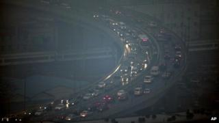Peak hour traffic snake along an elevated road in Beijing under heavy smog, 1 March 2012