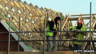 Builders building a roof
