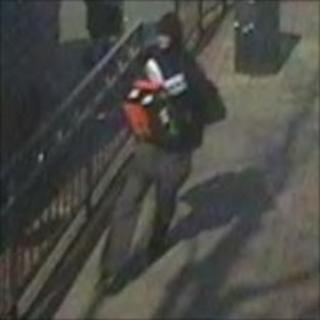 CCTV image of man carrying cash box
