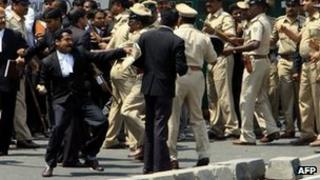 A Bangalore lawyer about to hurl a stone at the courthouse - 2 March 2012