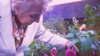 Elderly lady in garden