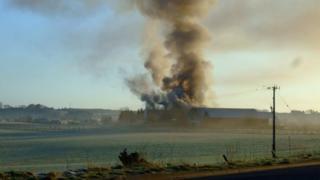 Smoke from fire at Gartwhinzean Hotel in Powmill