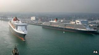 Queen Mary 2 steams past the other two liners in the Cunard fleet at Southampton Docks
