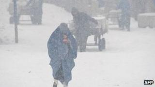 A woman in a snow storm in Kabul, Afghanistan (Feb 2012)