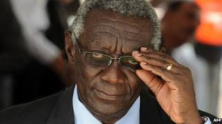 Former Ghanaian President John Kufuor adjusts his glasses during the ceremony marking Ghanaian first oil production in Takoradi on December 15, 2010