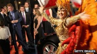 Prince Harry watches samba dancer