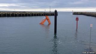 Digger submerged at Bridport