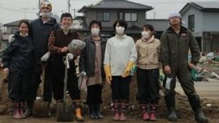 Hina Oishi's family wearing boots and masks in Ishinomaki. Copyright: Hina Oishi