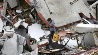 A Palestinian boy walks through the rubble of a destroyed building in Jabaliya. Photo: 12 March 2012
