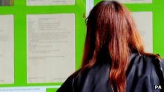 Woman looks at job ads