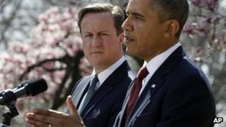 David Cameron looks on as Barack Obama speaks during a press conference 14 March 2012