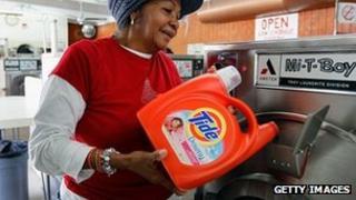 Woman using Tide in a washing machine