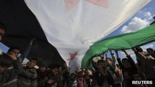 Children with a Syrian independence flag during a demonstration against President Bashar al-Assad in Hazzano, Idlib province