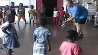 Jon Skinner playing with some of the children at the orphanage