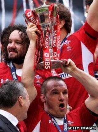 Wales prop Gethin Jenkins celebrates with the Six Nations trophy