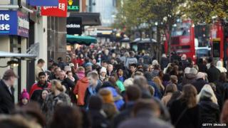People shopping in a busy high street