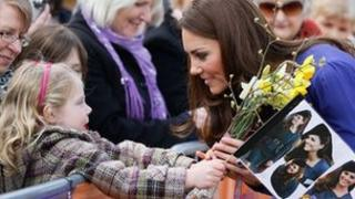 Duchess of Cambridge talks to a young girl during a visit to Each, Ipswich
