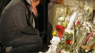 A man cries at a makeshift shrine at the Ozar Hatorah Jewish school in Toulouse