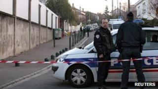 French police stand guard outside the Ozar Hatorah Jewish school a day after the shooting in Toulouse,