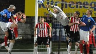 Derry City and Linfield players in action