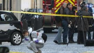 Police officers work at the site of a bomb explosion near the Indonesian Embassy, in Paris, Wednesday 21 March 2012