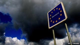Dark clouds with a European Union flag