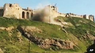Shell striking castle in Hama