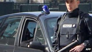 A police car possibly carrying Abdelkader Merah arrives at anti-terrorist police headquarters in Paris, 24 March
