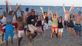 Pupils from the Minaki High School for Boys, in Tanzania, and Imberhorne School, in East Grinstead, jumping on African beach