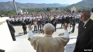 Pope Benedict waves to a crowd in Santiago de Cuba