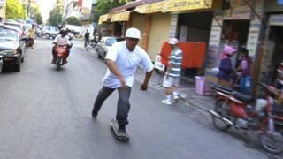 Sam skateboarding