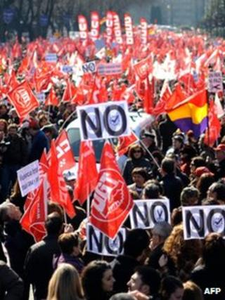 People gather on February 19 2012 in central Madrid during a demonstration against sweeping labour market reforms