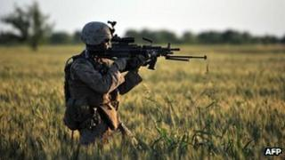 US Marines Lance Corporal Michael Horne gets ready to open fire in Sistani, Helmand Province May 7, 2011