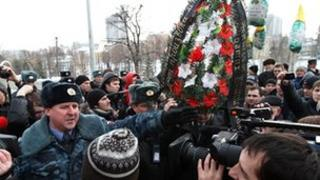 Policemen argue with demonstrators protesting against police brutality in the Russian city of Kazan on 15 March 2012