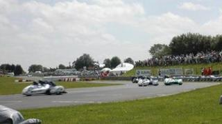 Racing at Castle Combe circuit in Wiltshire