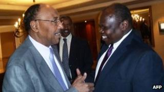 Sudan's Minister of Defence, Abdel-Rahim Mohamed Hussein (L), greets Pagan Amum, chief negotiator for South Sudan ahead of security talks in Addis Ababa (April 2, 2012)